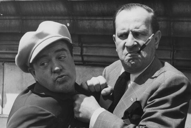 1950: American comedy duo Bud Abbott (1895 - 1974) and Lou Costello (1906 - 1959) who starred in over 35 films together, during a visit to England. (Photo by Central Press/Getty Images)